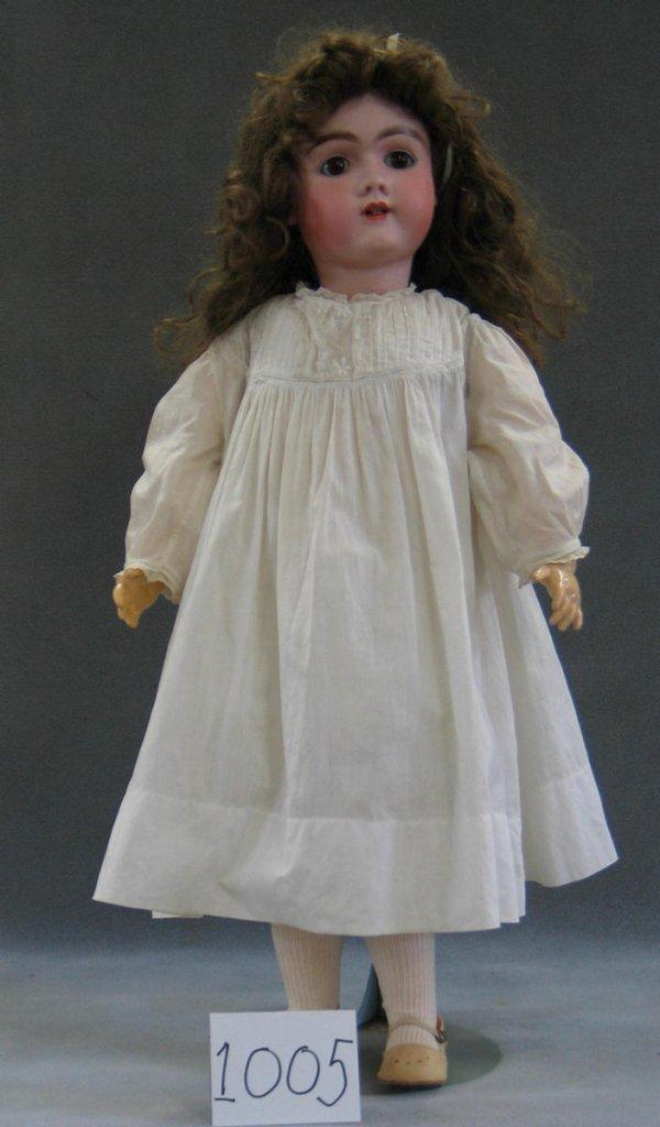 1005: Unmarked German bisque head child doll, body mark