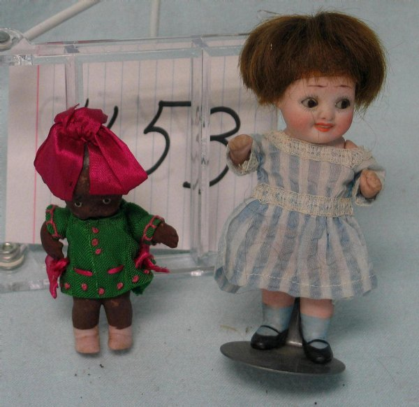 1153: Lot of two bisque googly-eyed dolls.