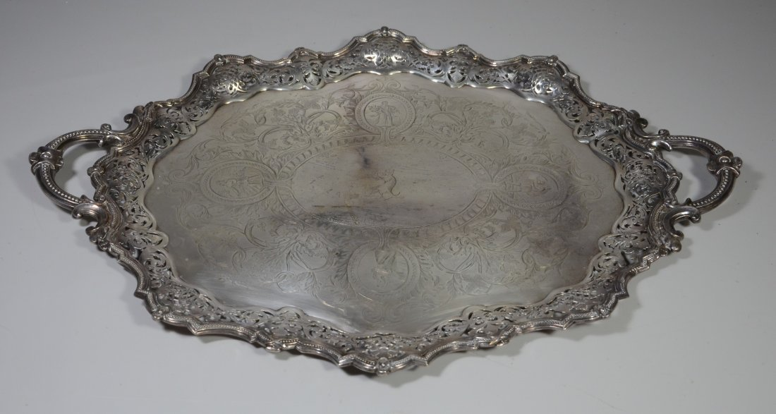 Ornate oval scalloped and pierced  plated silver