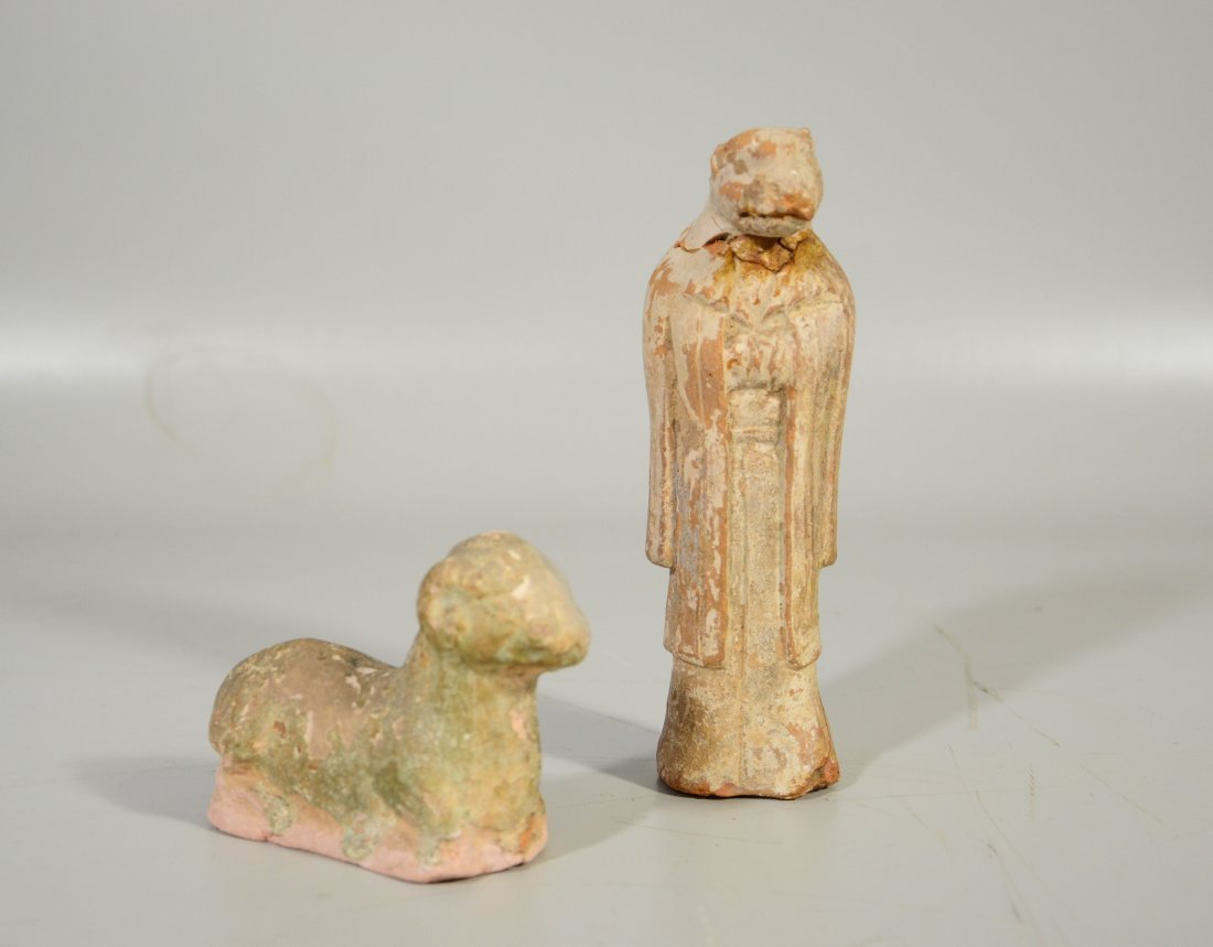 Pair of early Tong style glazed terra cotta clay