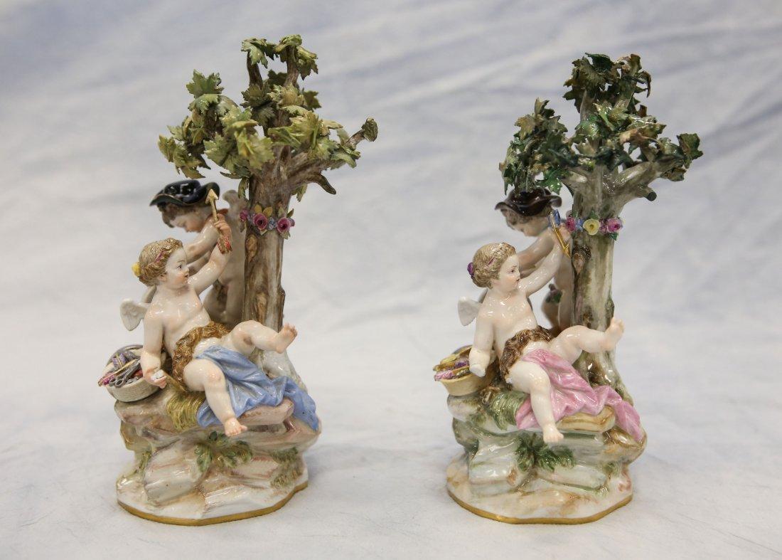 2 Meissen figurines, cherubs with trees, one missing