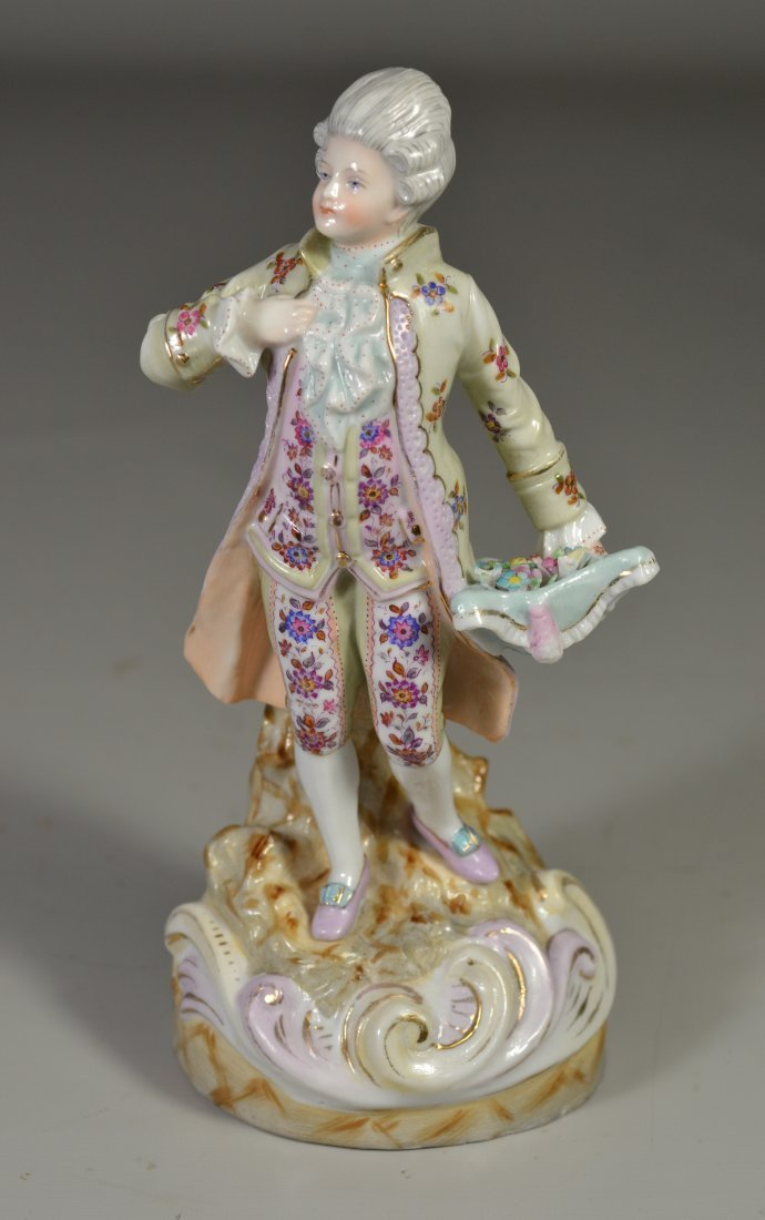 Continental porcelain figurine, man carrying