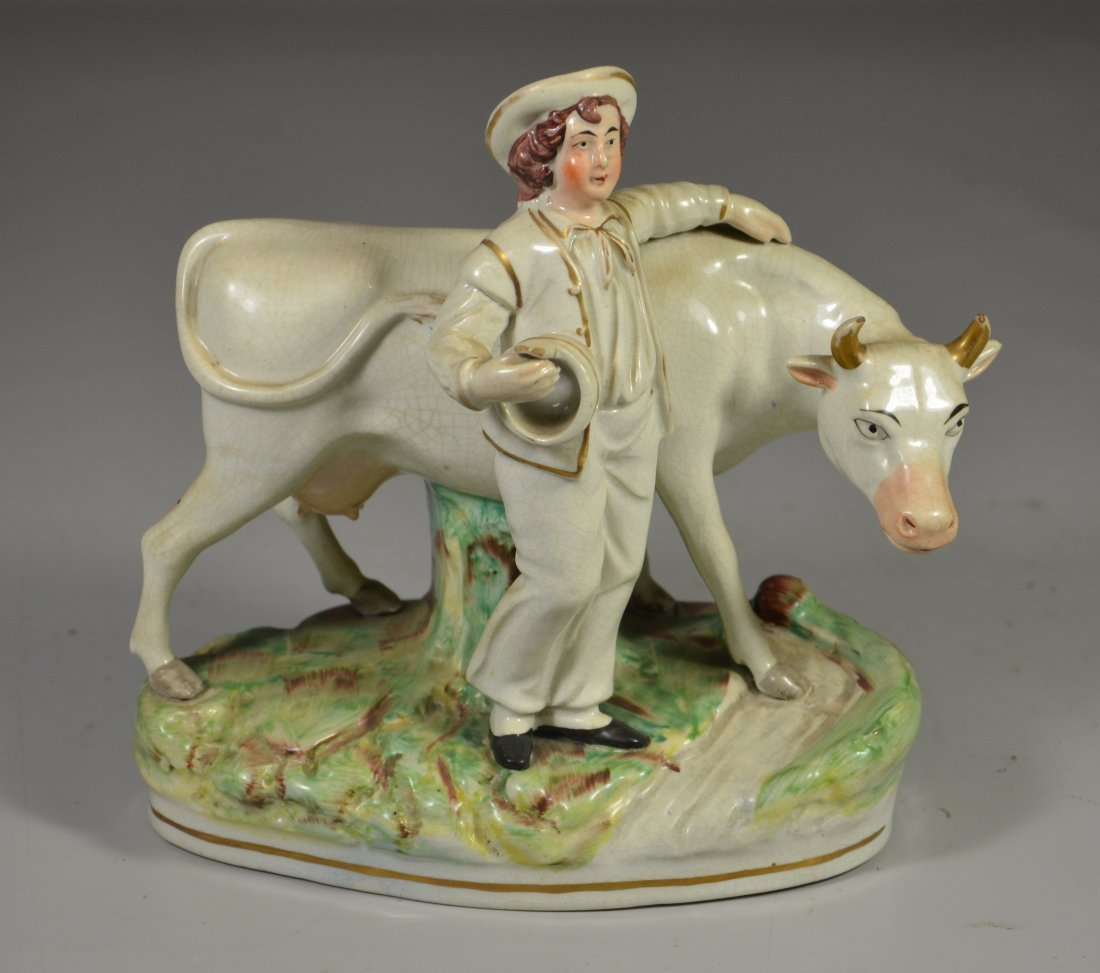 Staffordshire pottery figurine, young man with cow,