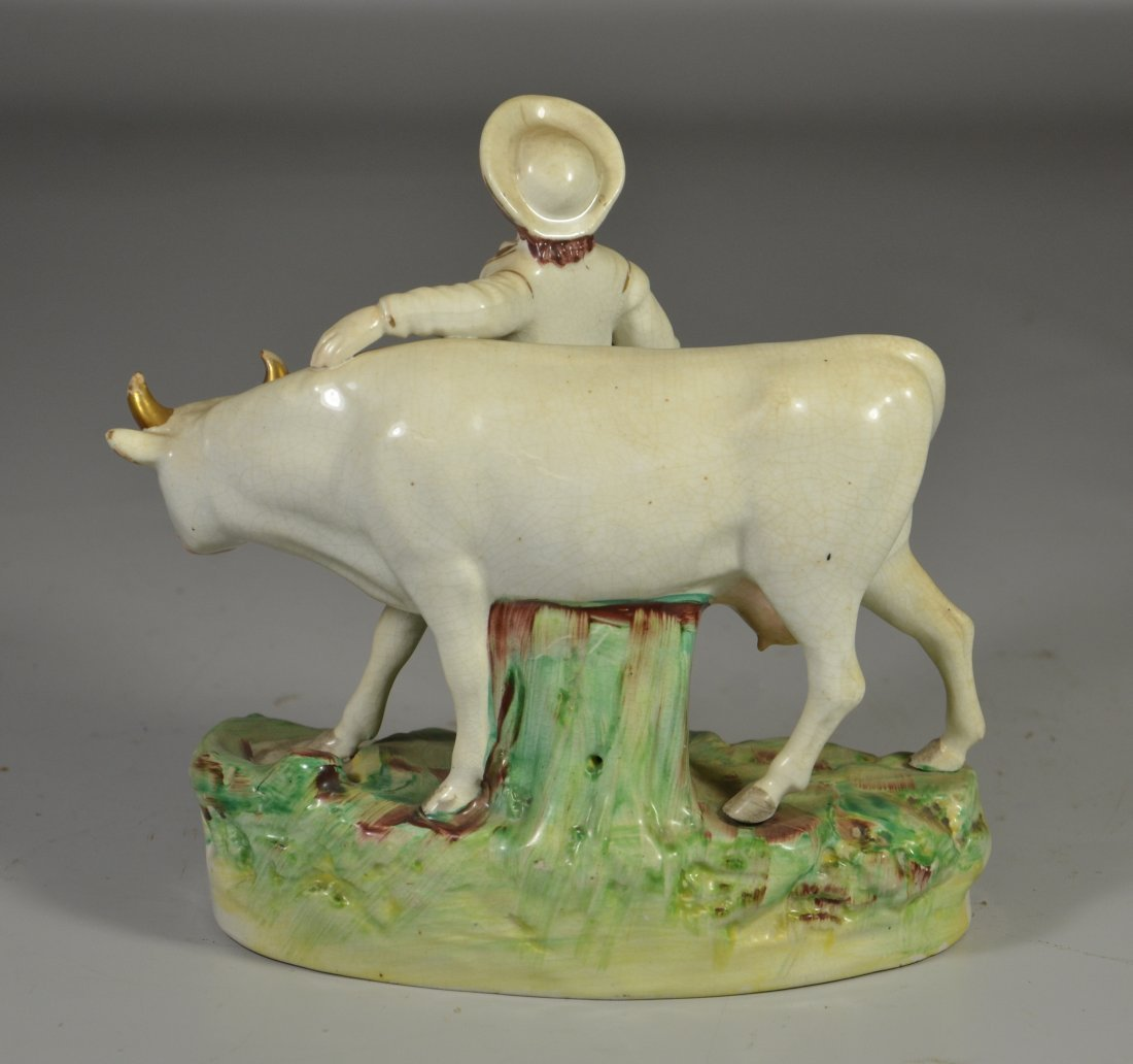Staffordshire pottery figurine, young man with cow, - 2