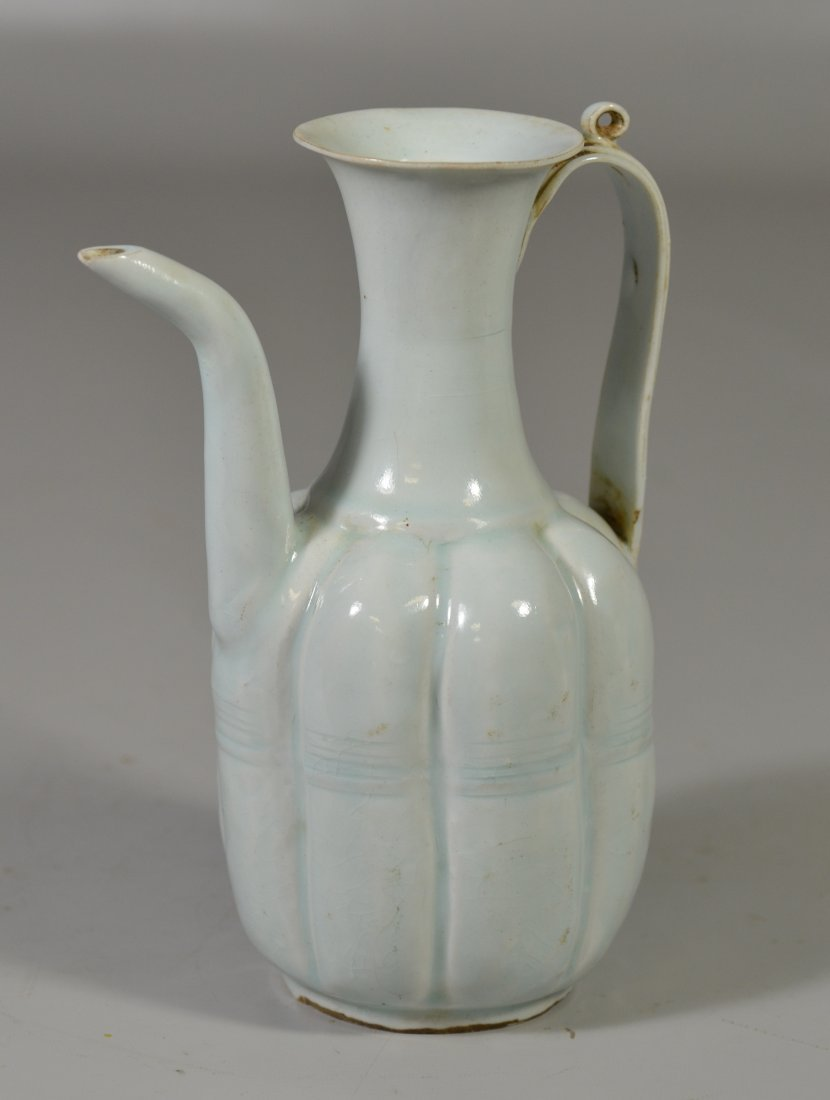 Early Chinese pale celadon ewer with minor chip to lip,