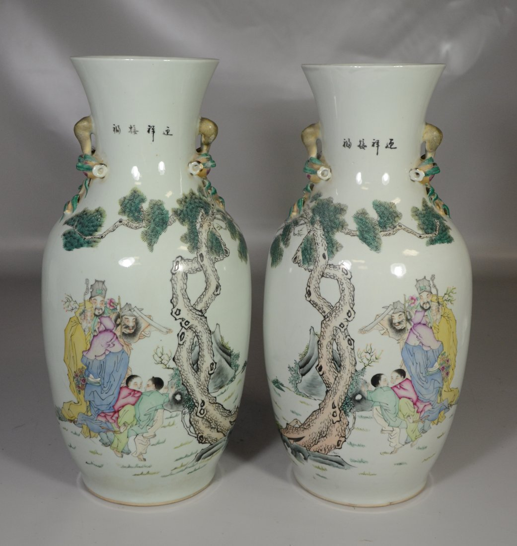 Pair of Chinese porcelain vases with figures in a