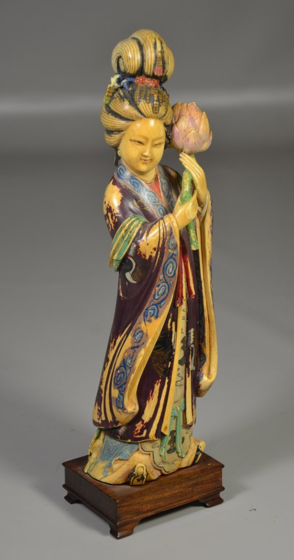 Polychrome figure of young maiden holding lotus