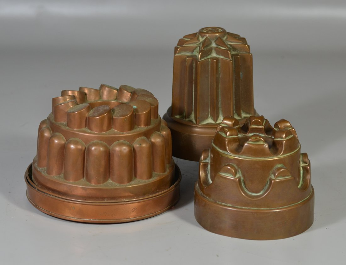Three (3) copper molds, one with lid, one marked