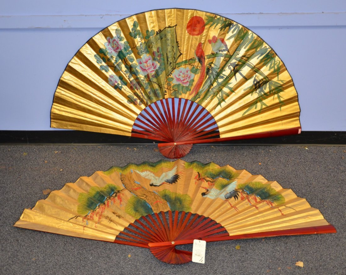 (2) Red lacquer folding fans with handpainted bird