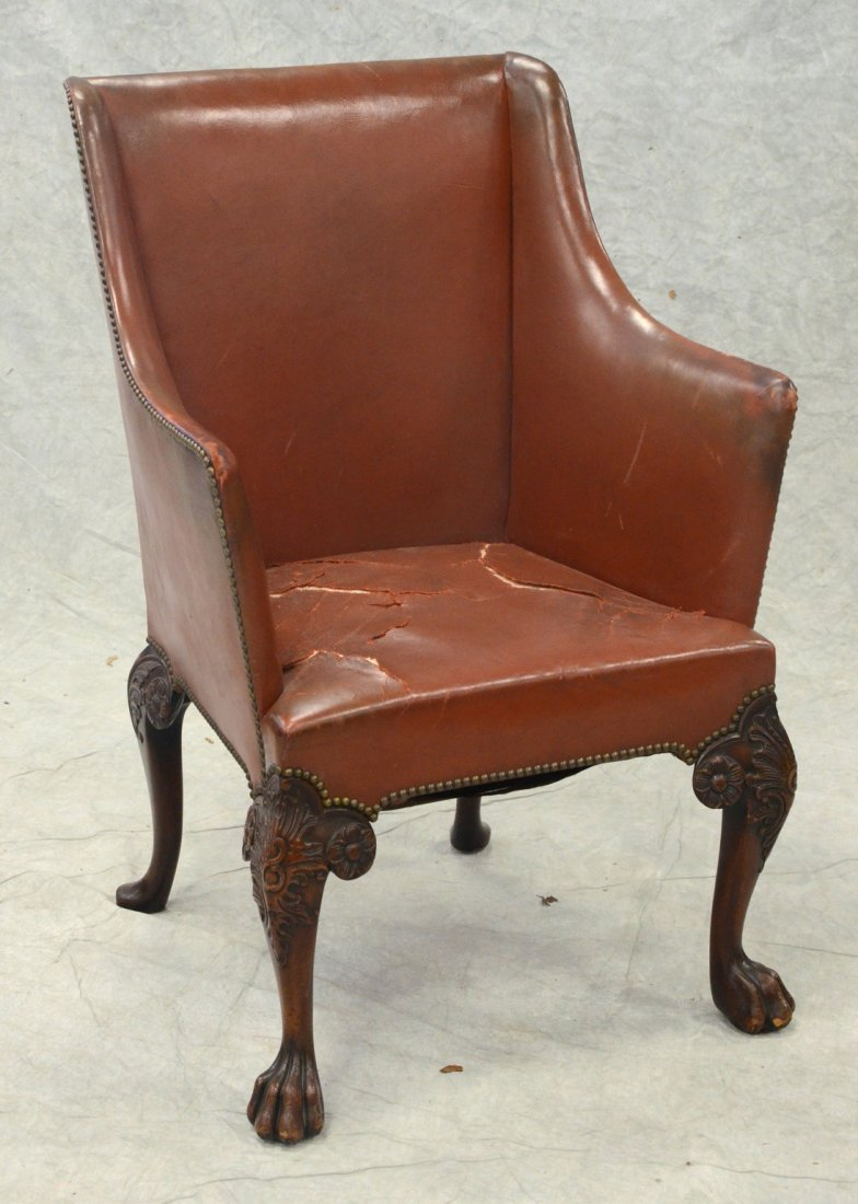 Leather upholstered carved mahogany Irish Queen Anne