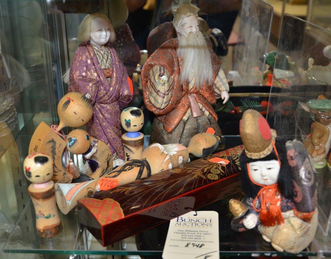 (8) Asian pieces, including 4 Kokeshi figures, 3 dolls