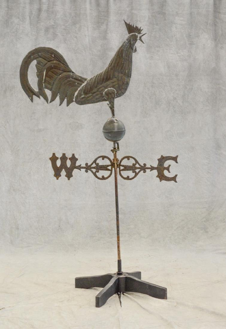 Molded copper rooster weather vane on cast iron