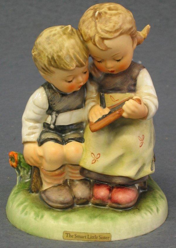 1007: Hummel Figurine, The Smart Little Sister