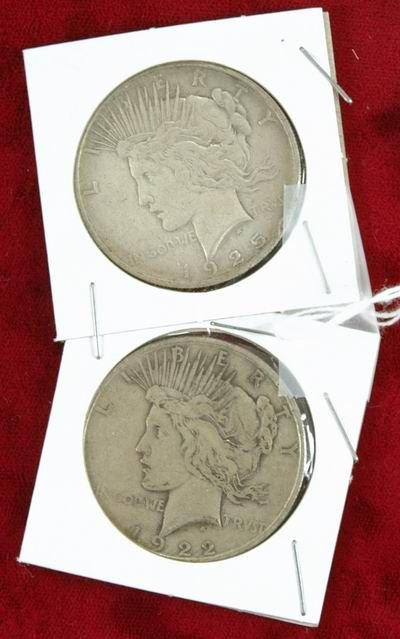 601P: 2 PEACE SILVER DOLLARS 1922 AND 1925