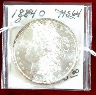 601I: 1884 MORGAN SILVER DOLLAR MS64