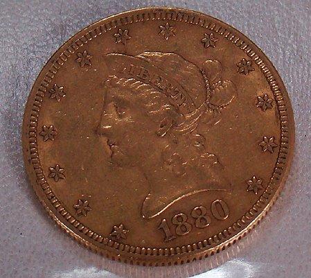 423: 1880 TEN DOLLAR GOLD LIBERTY COIN