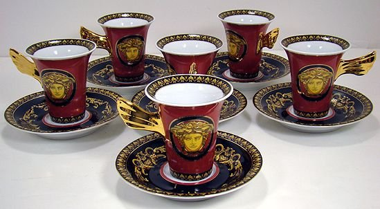 1052: SET OF VERSACE CUPS AND SAUCERS
