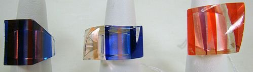 1212: GROUP OF 3 COLORED LUCITE RINGS