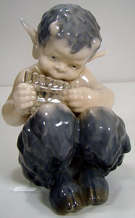 1217: ROYAL COPENHAGEN FAWN WITH PIPES FIGURE