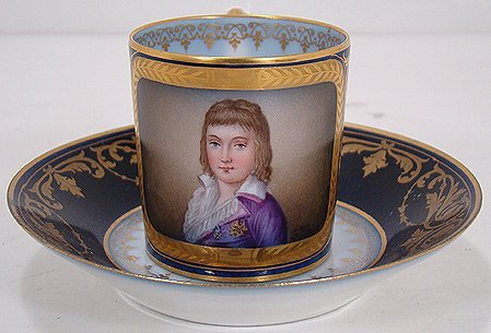 601A: SIGNED SEVRES PORTRAIT CUP AND SAUCER