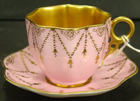 602: COALPORT PINK AND GOLD DEMI CUP AND SAUCER