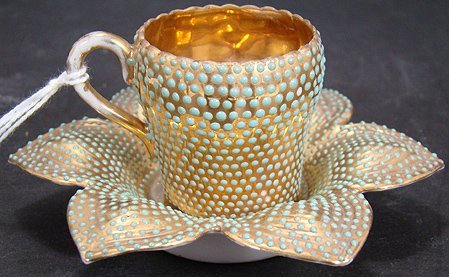 603: JEWELED MINIATURE CUP AND SAUCER