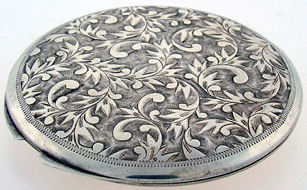 608: ROUND STERLING SILVER COMPACT BRIGHT CUT DESIGN