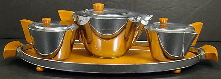 132: 4 PIECE CHROME AND BAKELITE TEA SET WITH TRAY MODE