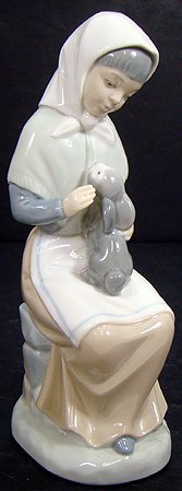 9: NAO BY LLADRO  GIRL WITH HER BUNNY RABBIT