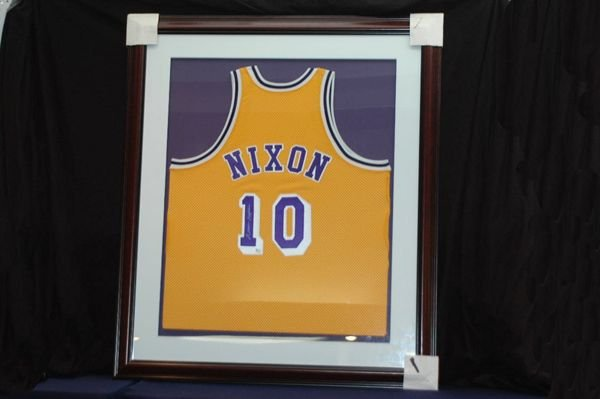 464: NORM NIXON AUTOGRAPHED AND FRAMED JERSEY W/COA