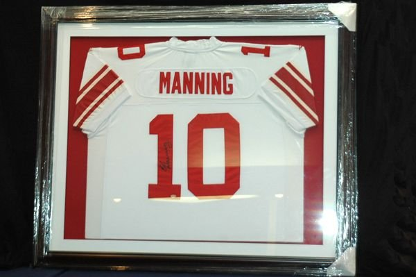467: ELI MANNING AUTORAPHED AND FRAMED JERSEY W/COA