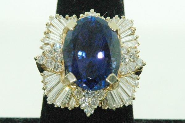 838: 14KT Y.G. 15.00CT TANZANITE AND DIAMOND RING