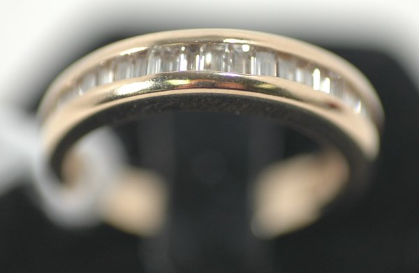 15: LADY'S DIAMOND AND YELLOW GOLD BAND RING