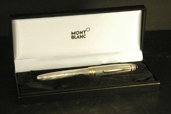 1202: AUTHENTIC MONTBLANC STERLING AND GOLD PEN W/BOX