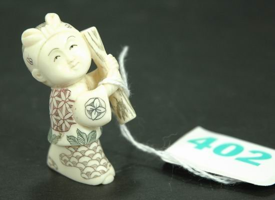 402: ANTIQUE IVORY NETSUKE OF A LITTLE GIRL APPROXIMATE