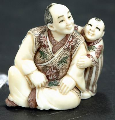 403: ANTIQUE IVORY NETSUKE OF A MAN AND HIS SON APPROXI