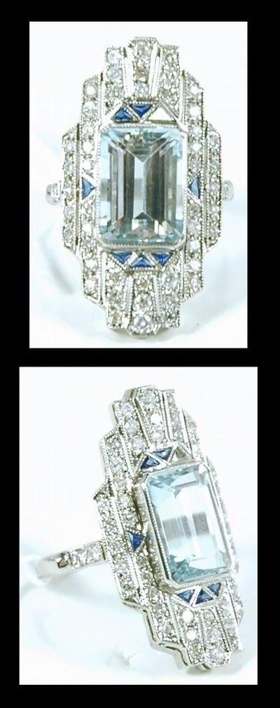 17: MAGNIFICENT PLATINUM AQUAMARINE AND DIAMOND RING