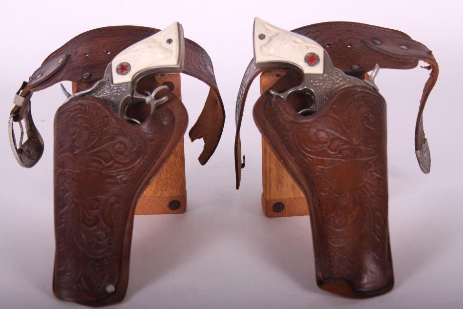 Pr of Hubley Texan Cap Guns, Cast Iron, w/ Leather