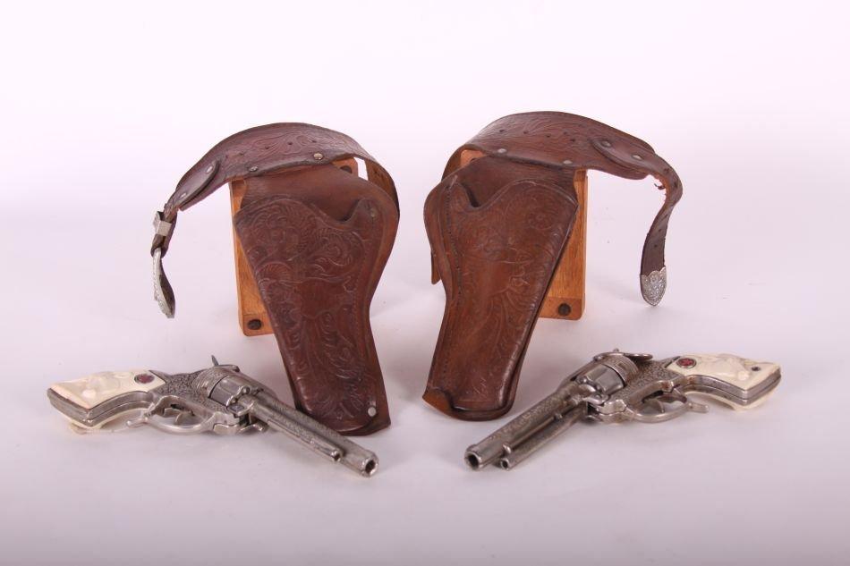 Pr of Hubley Texan Cap Guns, Cast Iron, w/ Leather - 2