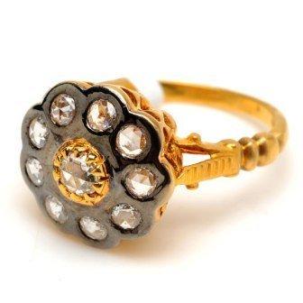18K Gold  6.103 Grams   Diamonds  0.69Ct  -    -