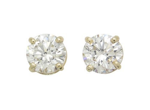 These exquisite earrings feature two impressive round b