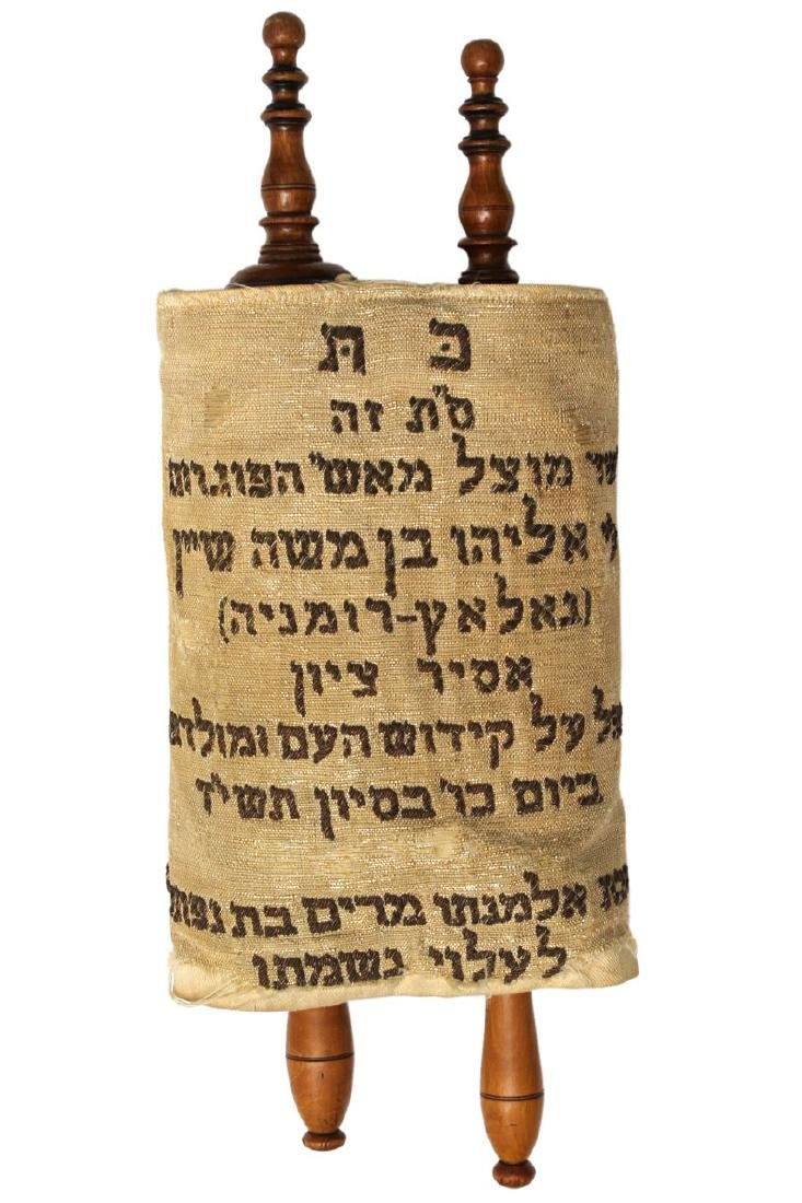 Miniature sefer Torah written by hand on parchment in