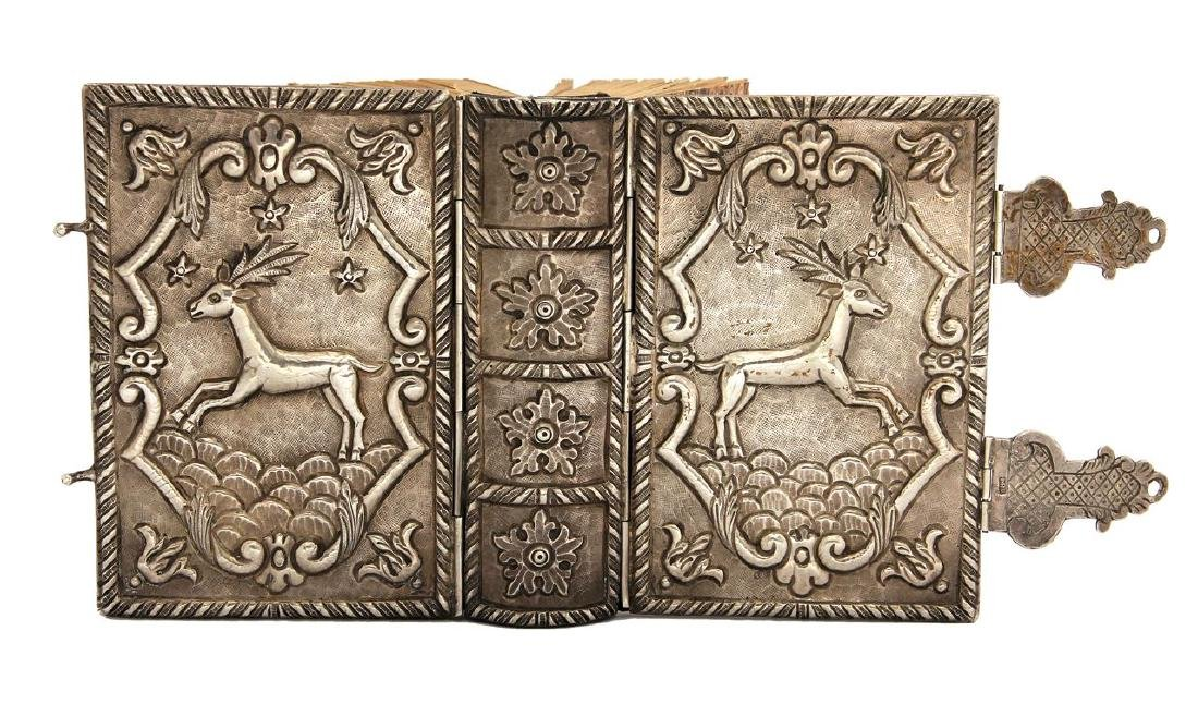 Pretty silver binding. End of the 20th century.