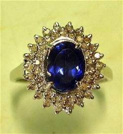 A Tanzanite and Diamond Cluster Ring With ova