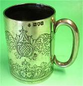 A Silver Mug Foliate engraved and inscribed