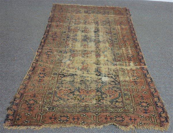 Worn old Persian Rug