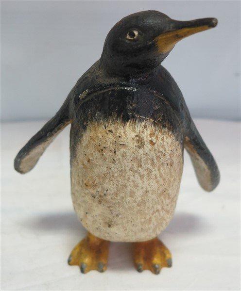 """8"""" cast iron penguin bank"""