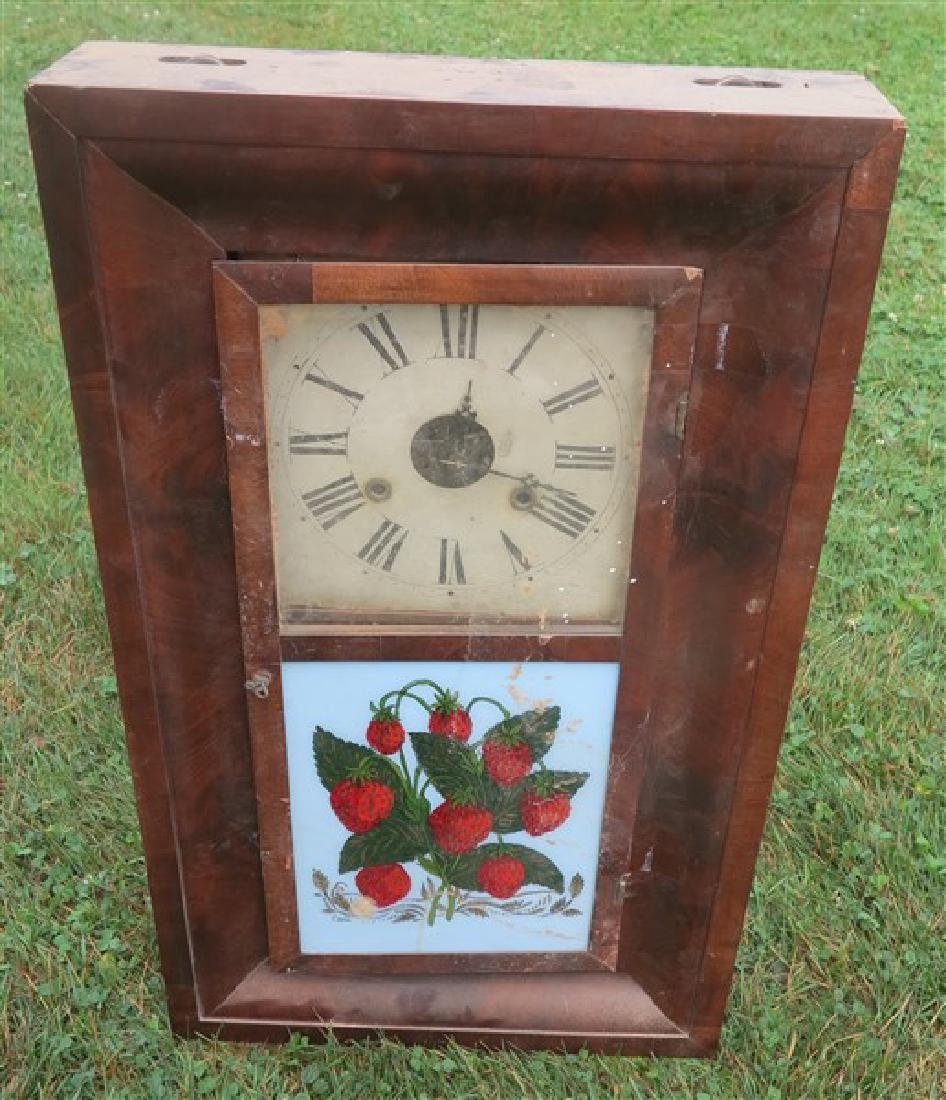 Mantle clock with strawberry tablet