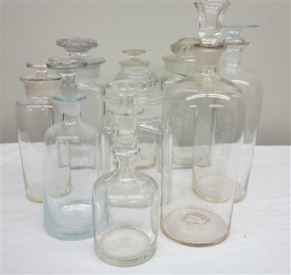 9 glass covered jars