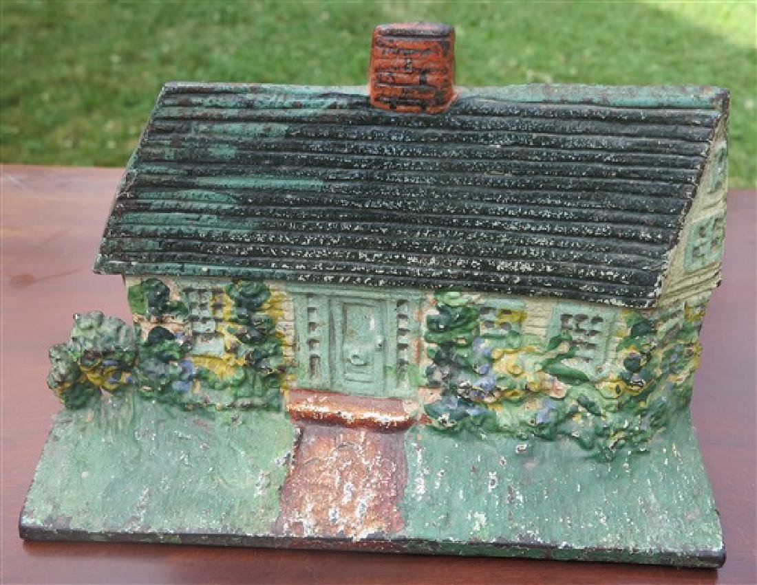"Vintage cast iron ""cottage"" doorstop"